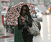 Slide Photo of Avatar Star Zoe Saldana Under an Umbrella in the Rain