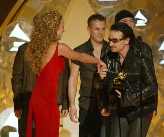 The guys of U2 looked thrilled to meet Britney Spears in 2002.