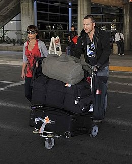 Photos of Sam Worthington Arriving at LAX With Lots of Luggage