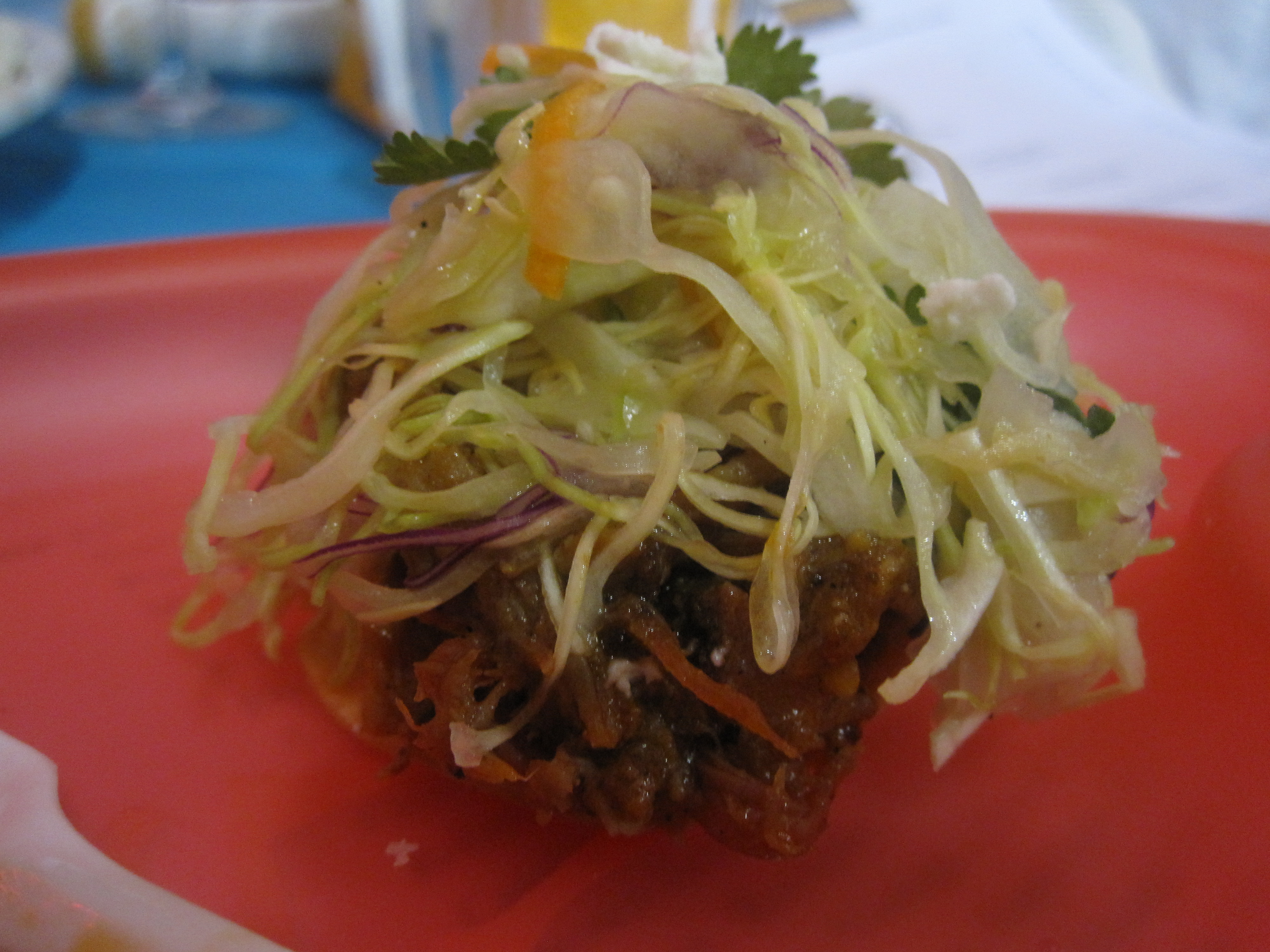 This miniature taco was a one-bite taste sensation. It had a crunchy bottom, juicy pork topping, and crisp coleslaw garnish.