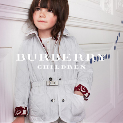 In her sporty yet sophisticated jacket, this observant young girl seems ready to explore the world. This quilted short jacket gives your child warmth in colder weather. The ruched branded buckle belt is another detail that adds style to this classic quilted jacket.