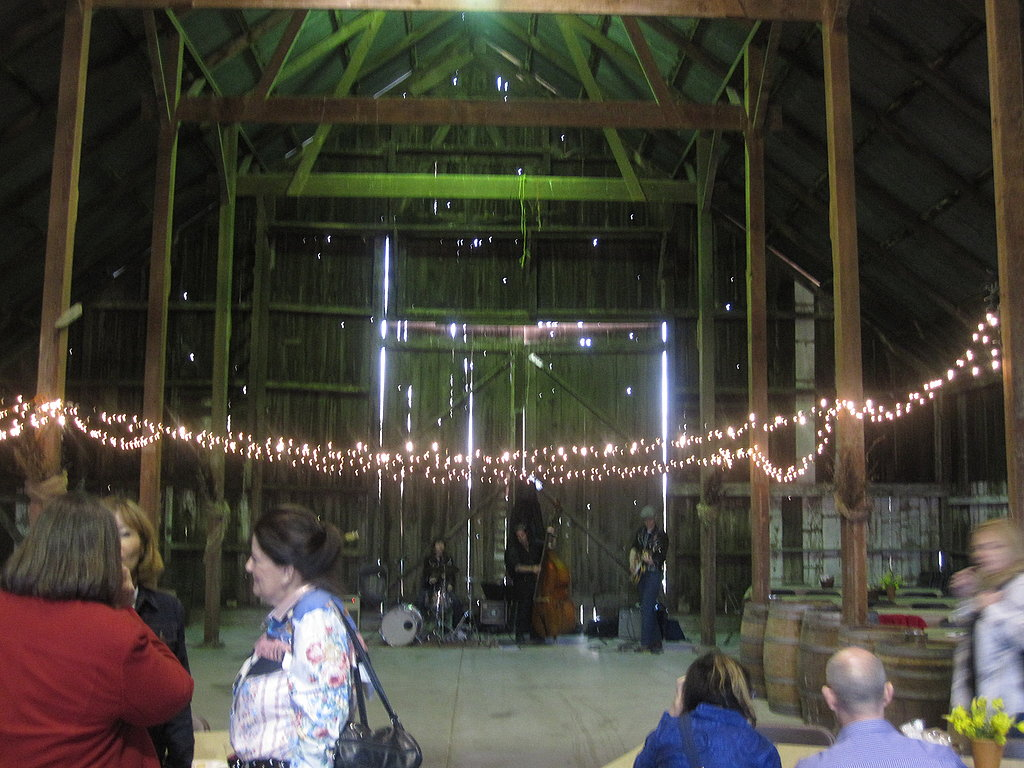 The band was playing at the end of the barn.