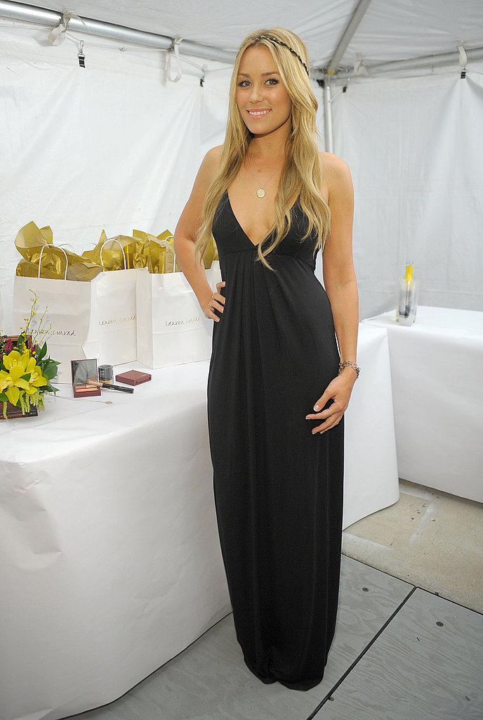 Backstage at the Lauren Conrad Collection SS '09 show in a dress from her own line.