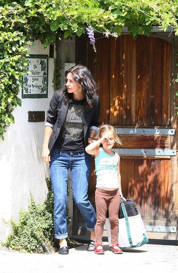 Courteney Cox's coif hangs past her shoulders.
