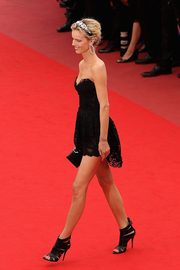 Eva looked like a dark swan in her Dolce & Gabbana lace mini frock.