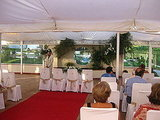 The ceremony took place inside a small tent.