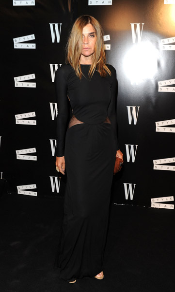 Carine Roitfeld wore a lot of black at Cannes. Here she is in yet another sultry black getup.