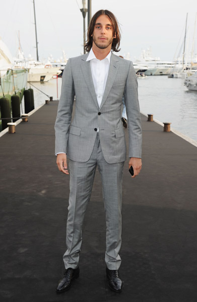 Vladimir Restoin-Roitfeld makes a gray slim suit look yummy.
