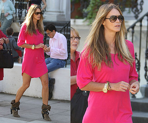 Elle Macpherson in London Wearing Hot Pink Isabel Marant Dress and Suede Tan Boots