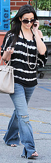 Kim Kardashian Wears Bebe Tie-Dye Top and Baggy Jeans in LA