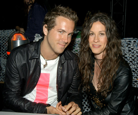 In 2003, Ryan Reynolds and then girlfriend Alanis Morissette held hands backstage.