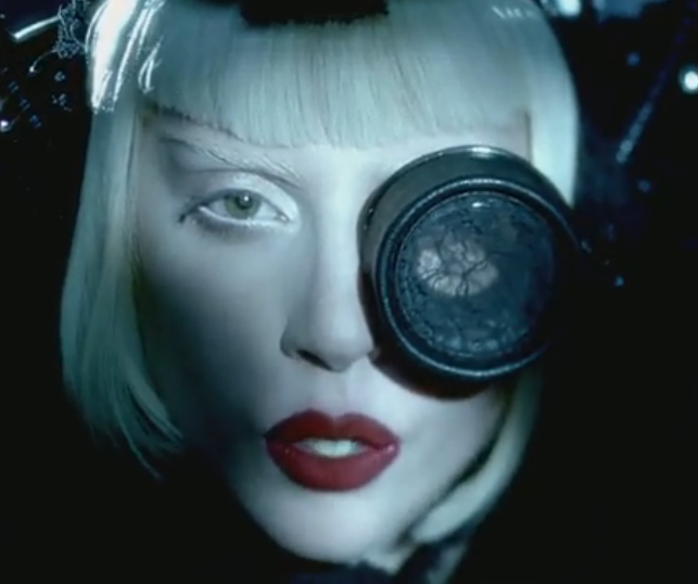 Gaga with one eye open, one eye in spectacle lace. Doesn't she look like Madonna here?