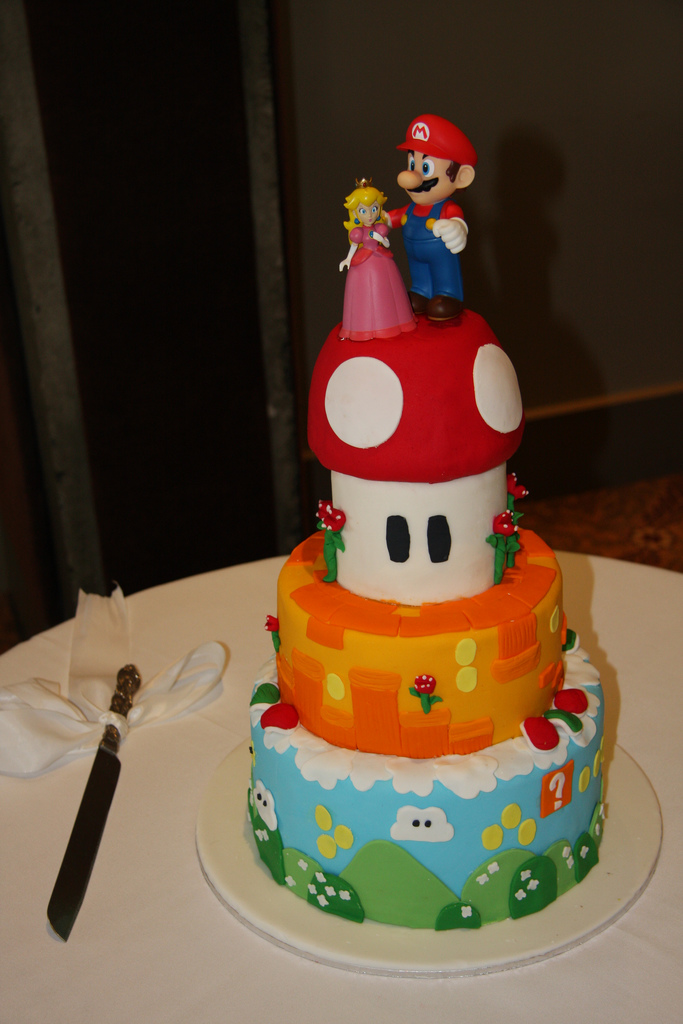 I love the middle orange layer on this cake.  Source: Flickr User AndyFitz