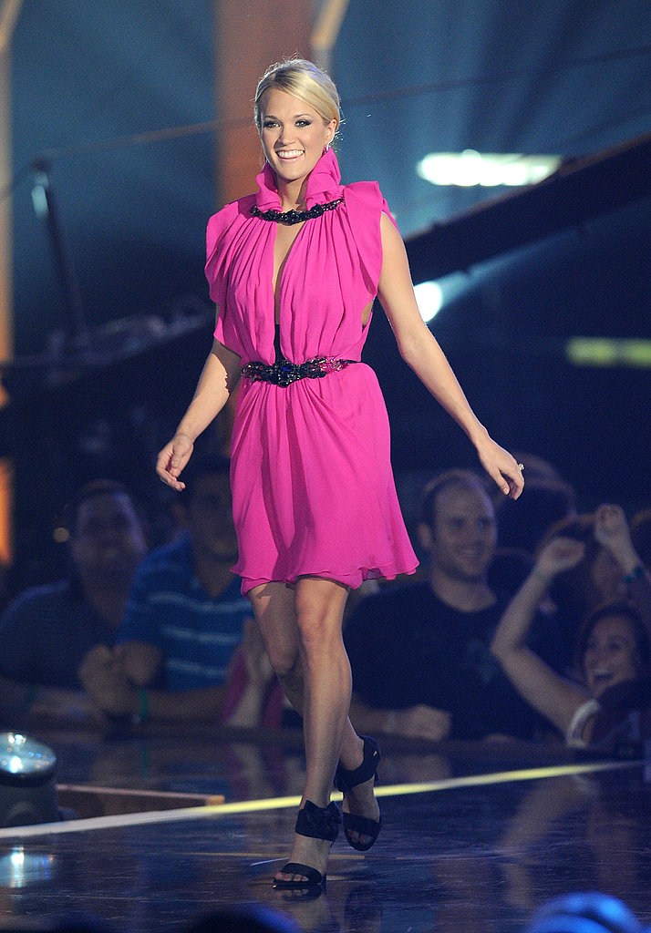 Carrie Underwood on stage in hot pink Jenny Packham.