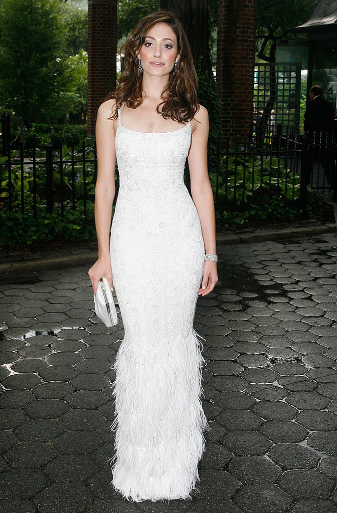 Emmy Rossum is a feathered dream in this white Marchesa — wow.