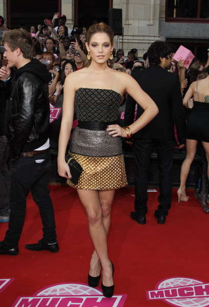 Ashley Greene in gold and black red carpet armor and black satin triple platform Casadei pumps.