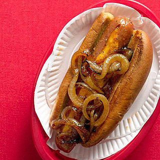 July Fourth Recipe For Cheese-Stuffed Hot Dogs with Spicy Onions