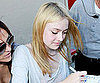 Slide Picture of Dakota Fanning Signing Autographs at Jimmy Kimmel in LA