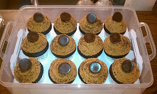 Dark Chocolate Cupcakes with Peanut Butter Frosting... dusted with cocoa powder and topped with miniature dark chocolate peanut butter cups.