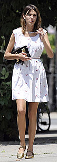 Alexa Chung Wears White Cherry Dress and Gold Ballet Flats
