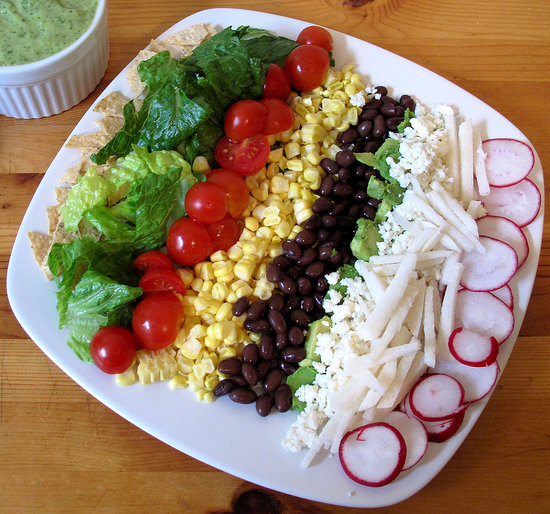A deconstructed taco salad gets a healthy boost and added crunch with raw corn, straight off the cob.