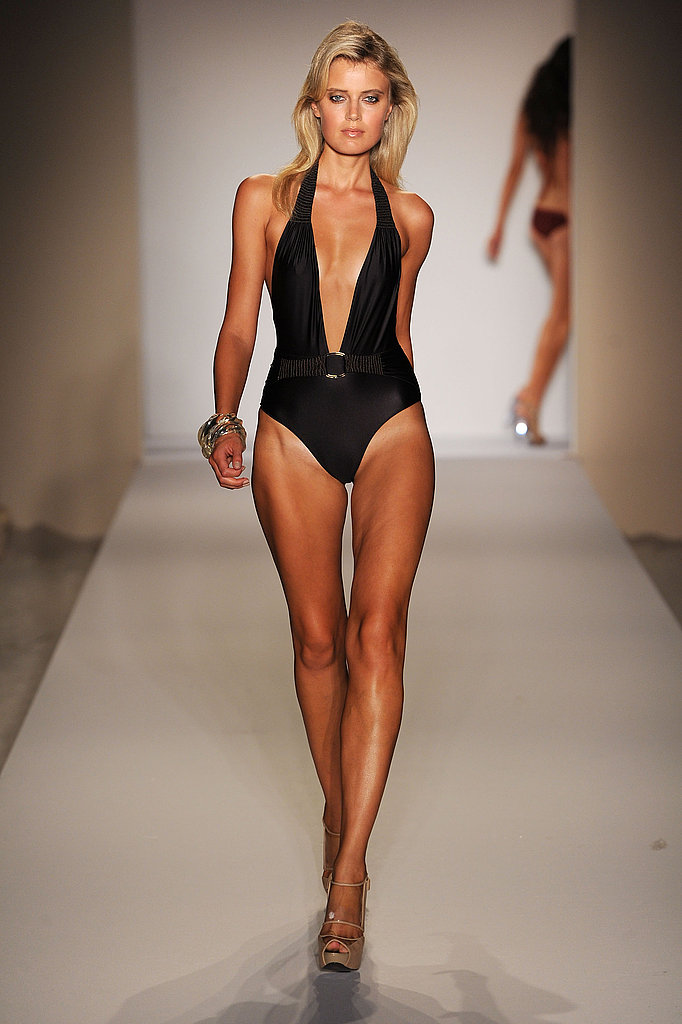 Nothing beats an updated classic; this deep-v black Crystal Jin one-piece is rockin'.