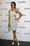 Zoe in a sage green cutout dress by Calvin Klein — get a similar look.