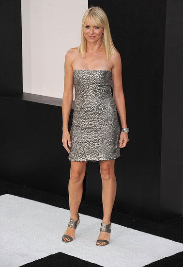 Naomi's silver streak in a one-of-a-kind strapless silver gunmetal sequined cocktail dress and sandals, both by Gucci.