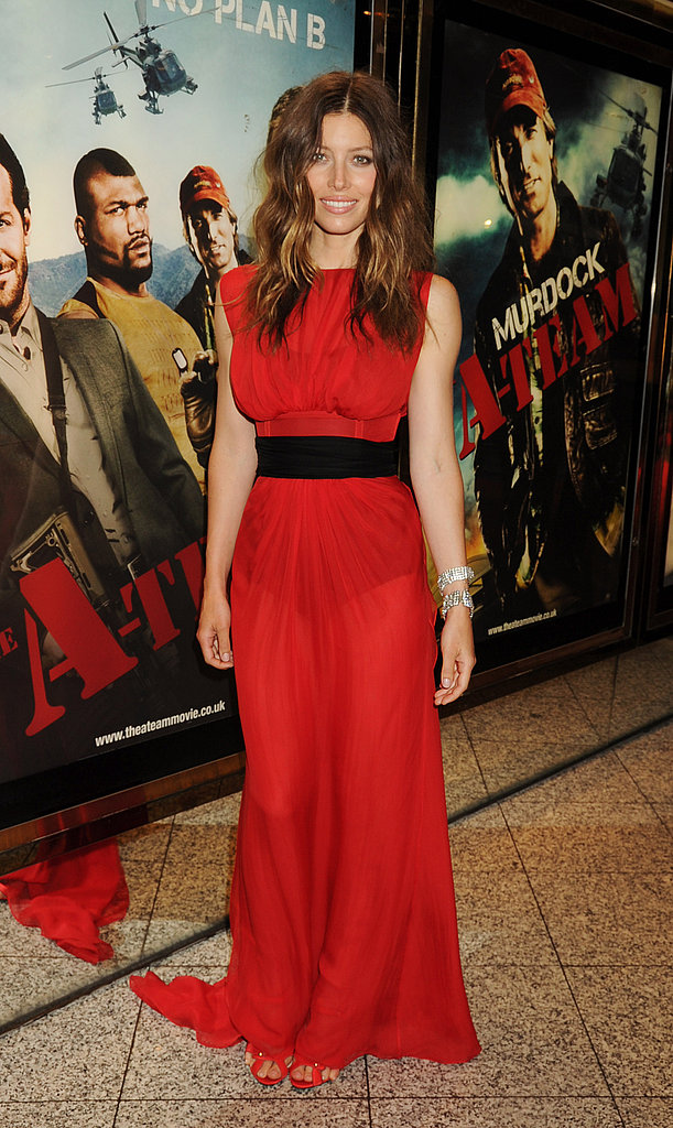 Jessica Biel stuns in red. The black belt is a modern touch, and glittering diamond bracelets bring on the glamour.
