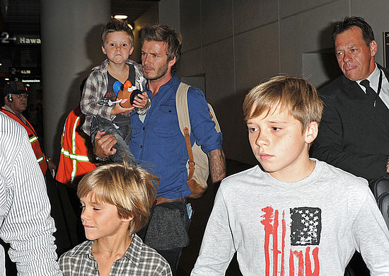 David Beckham and sons Brooklyn, Romeo and Cruz arrive at Los Angeles International Airport (LAX).