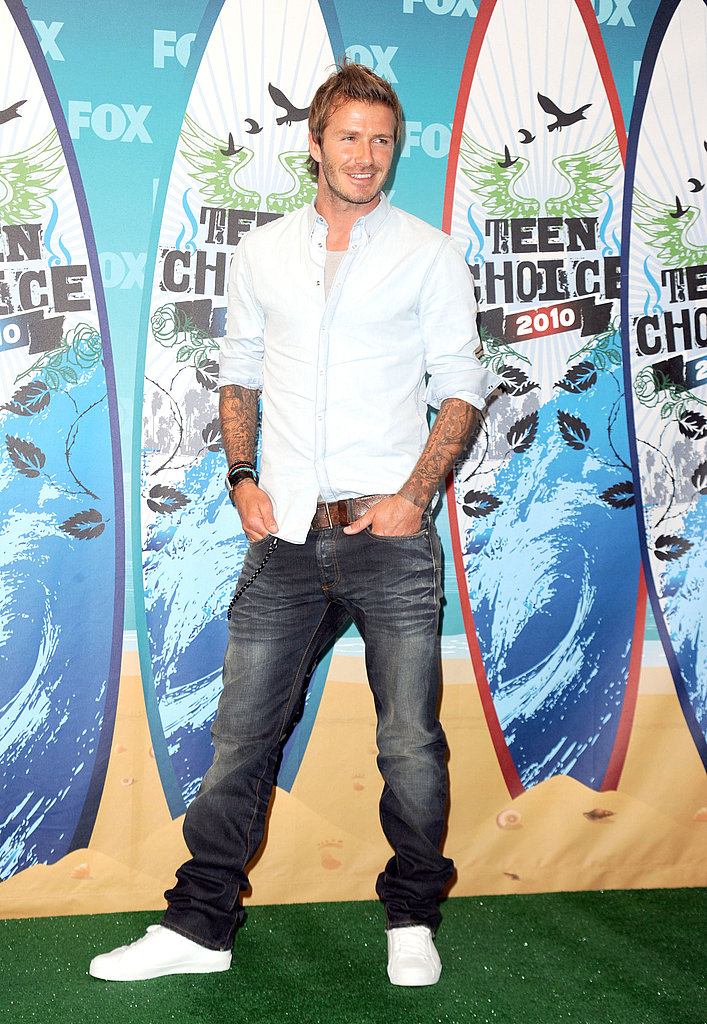 David Beckham makes a classic button-down, jeans, and white kicks look so damn good.