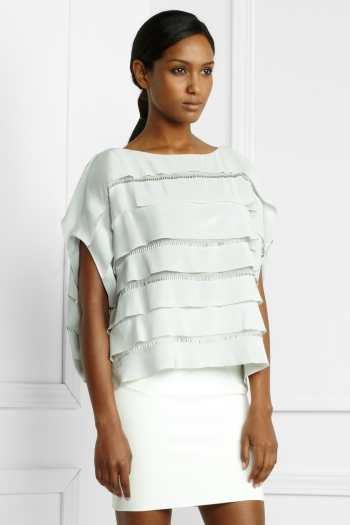 """. . . raw-edged silk tiers can bring sensual volume and movement to a casual top . . ."