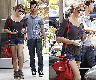 Ashley Greene Hanging Out With Joe Jonas in LA Wearing a Red Messenger Bag