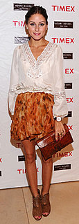 Olivia Palermo Wears Printed Skirt and White Top at Timex Event