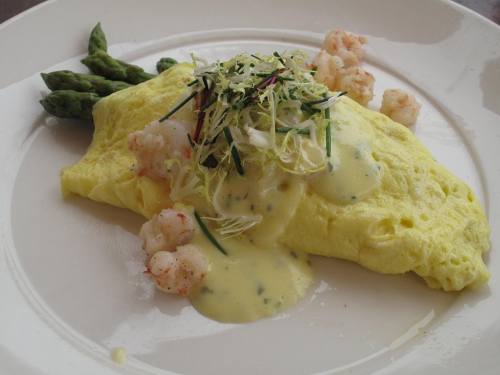 I ordered an omelet that was filled with rock shrimp and elegant stems of steamed asparagus spears, then drizzled with a béarnaise sauce.