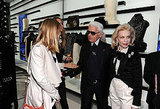 Gracious host Lagerfeld greets his guests.