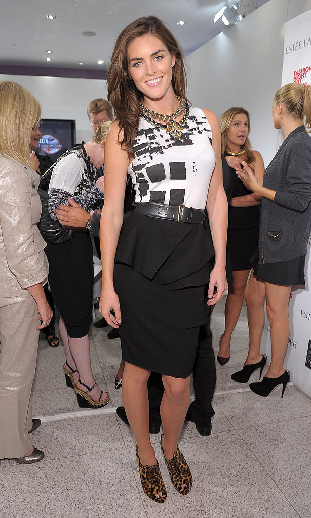 Hilary Rhoda mixes her FNO official gear with pencil skirt and cool kicks at Saks.