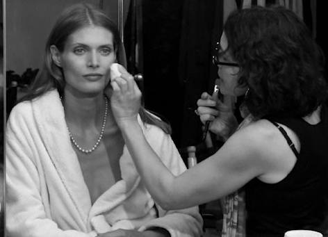 Malgosia gets touched up in a robe and pearls.