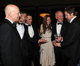 Bruce Willis, George Clooney, Matt Damon, Angelina Jolie, Jerry Weintraub, and Brad Pitt shared a cute laugh during a conversation at the UNICEF Ball in December 2009, in Beverly Hills, CA.