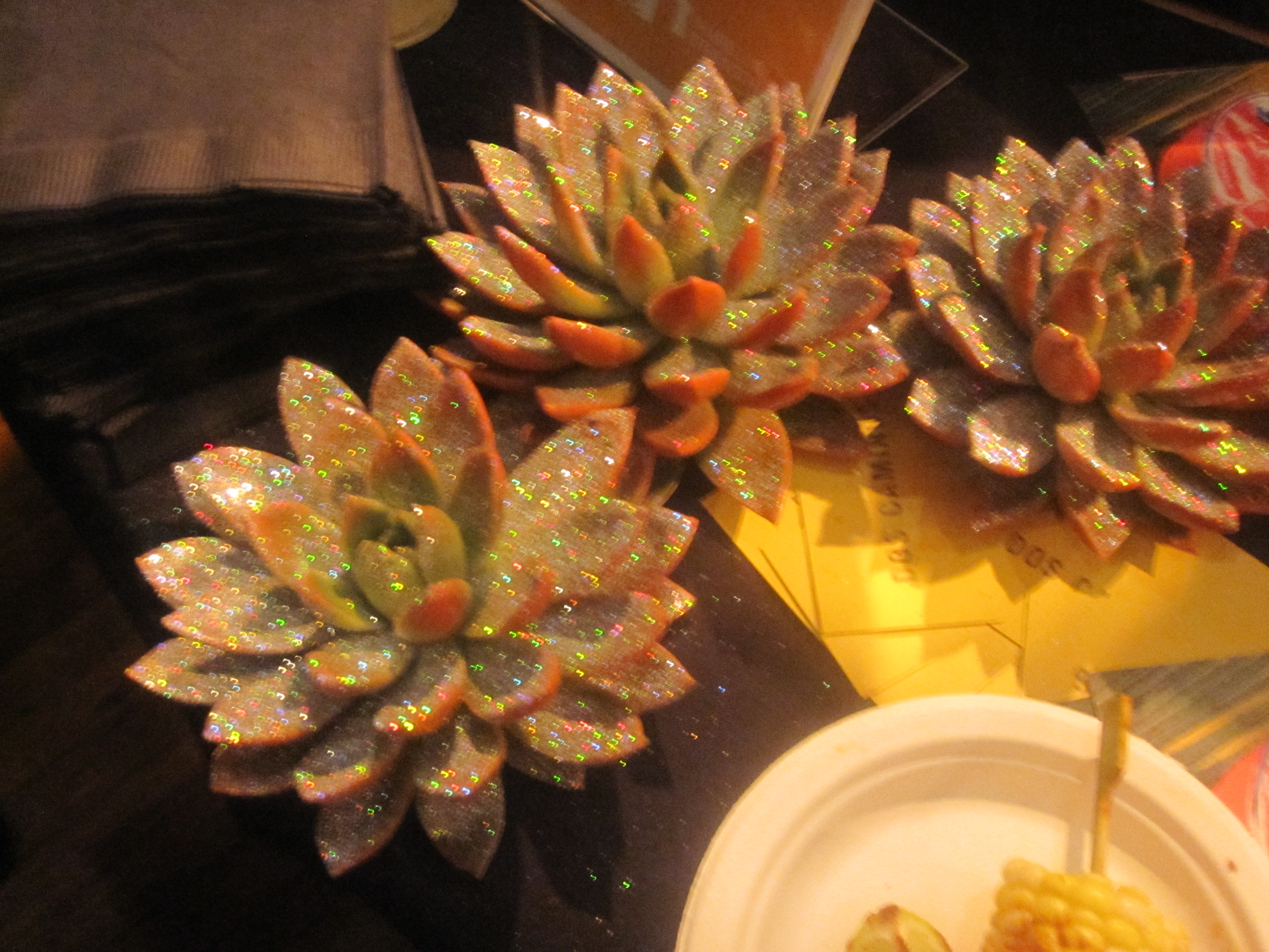 I loved this decorating idea: glittery succulents!