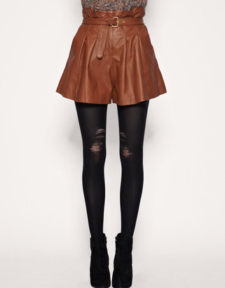 We wear torn denim, so why not torn tights? Rock these Jonathan Aston Ripped Tights ($17) with anything polished for cool contrast.