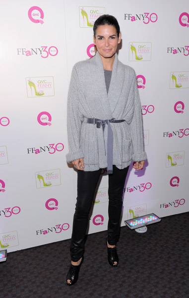 'Tis the time to be cozy, and Angie Harmon cozied up so well in her gray cardigan. The velvet ribbon keeps the look from being too casual.