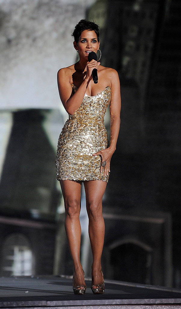 Halle Berry took the stage in a sparkly, metallic Reem Acra mini.