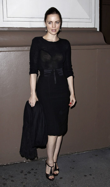 Melissa George was spotted in an all-black look consisting of a black pencil skirt and sheer black long-sleeved tee.