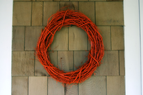 This one, from Wise Craft, is quick and easy:  Spray paint a grapevine wreath orange, and you're done!