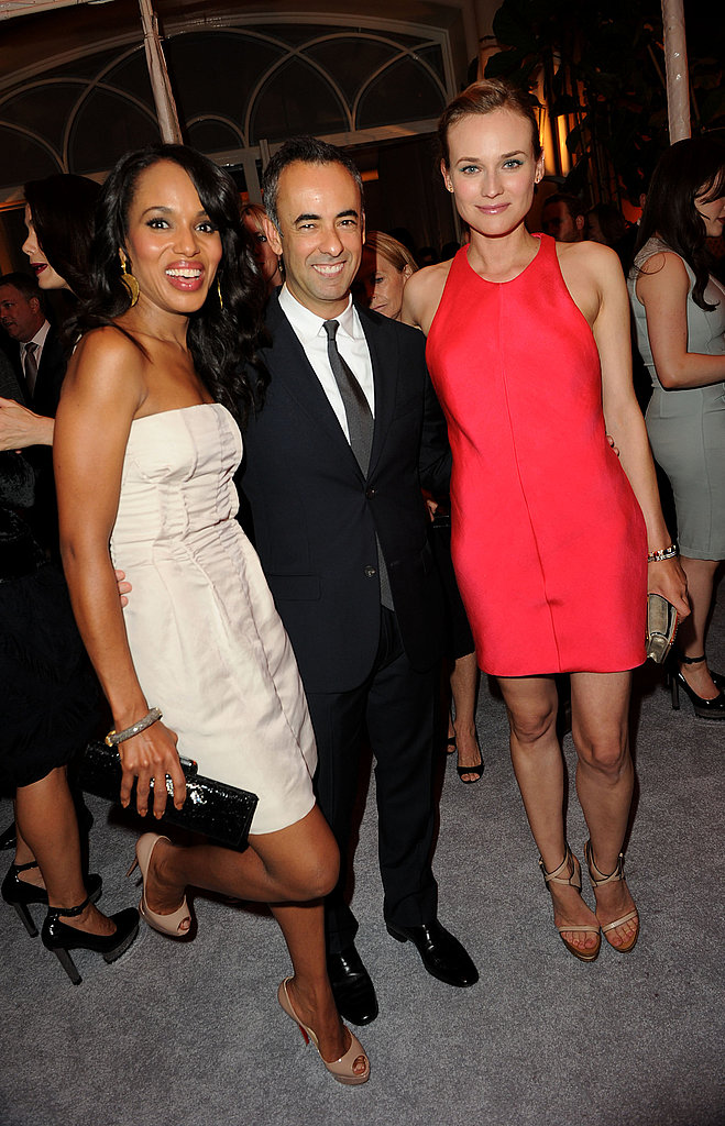 Lucky guy! The Calvin Klein designer flanked by beauties — and two of his dresses.