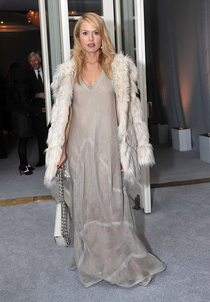 Rachel Zoe draped in a creamy palette and fur to match.