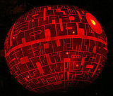 Fantasy Pumpkins shows you how to turn your orange globe into a Death Star.