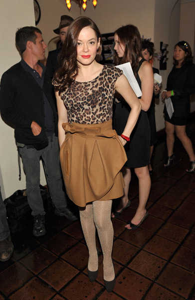 It's an unexpected, ladylike look from Rose McGowan. A little leopard and camel love done right.