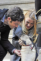 Blake Lively and Penn Badgley are seen playing with a pug and rehearsing their lines together.